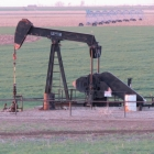 Pope_Ochiltree County_Pump Jack with Farming Equipment